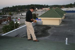 John Minor using thermal imaging on a commercial roof
