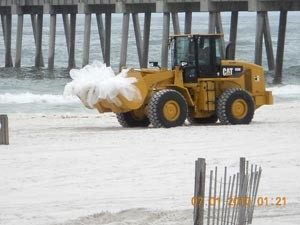 Cleaning up oil on Pensacola Beach