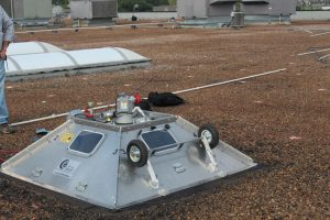 Uplift testing on built-up gravel ballasted roof. Photo by Complete.